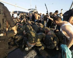 Surrendered Turkish soldiers who were involved in the coup are beaten by civilians on Bosphorus bridge in Istanbul